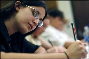 girl-student-writing-in-exam